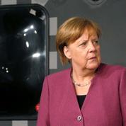 États-Unis : Merkel contrainte d'adopter un profil bas, après la visite de Macron