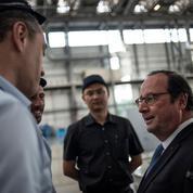 En visite à Pékin, François Hollande reçu en grande pompe par Xi Jinping