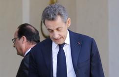 Nicolas Sarkozy quitte l'Élysée après sa rencontre avec François Hollande, dimanche à Paris.