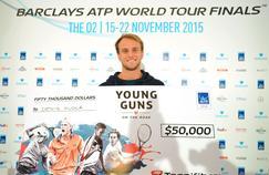 Denis Kudla et son chèque de 50.000 dollars qui va lui permettre d'aborder 2016 avec sérénité.