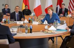 Barack Obama, Angela Merkel et François Hollande lors d'un sommet à Hanovre, lundi.
