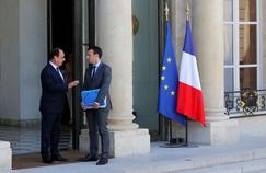 François Hollande et Emmanuel Macron, le 17 août dernier.