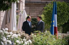 François Hollande et Emmanuel Macron, le 31 juillet,au Palais de l'Élysée.
