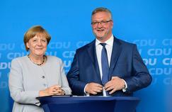 La chancelière Angela Merkel et Frank Henkel lors d'un meeting de la CDU à Berlin, le 14 septembre.