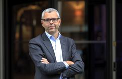 Michel Combes, directeur général d'Altice, la maison mère de SFR