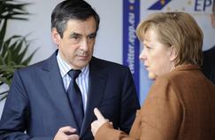 François Fillon, alors premier ministre, et la chancelière allemande Angela Merkel, le 24 mars 2011, à Meise, en Belgique, lors d'un sommet européen sur la Libye.
