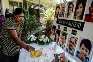 En Malaisie, des proches de victimes rendent un hommage aux 239 disparus, le 8 mars 2016.