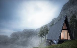 Une maison triangulaire en verre au bord d'une falaise