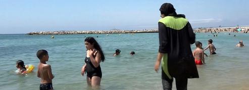 Plusieurs communes interdisent désormais le burkini sur leurs plages