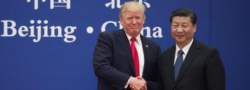 Trump signe pour 250 milliards de dollars d'accords commerciaux en Chine