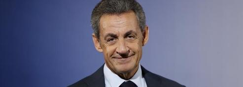 Nicolas Sarkozy à livres ouverts
