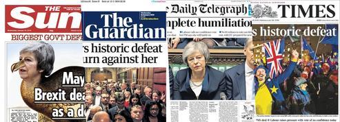 «Humiliation totale», «catastrophique»... Le revers de Theresa May vu par la presse britannique