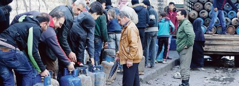 L'Amérique et l'Europe frappent la Syrie au portefeuille