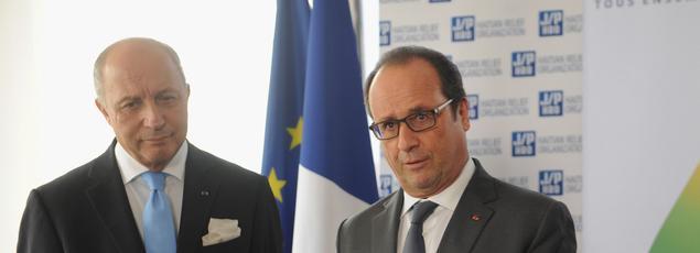 Laurent Fabius, ministre des affaires étrangères et François Hollande, président de la République
