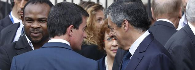 Manuel Valls et François Fillon, le 27 juillet à Paris, lors de l'hommage au père Jacques Hamel, sauvagement assassiné dans son église par deux djihadistes, à Saint-Étienne-du-Rouvray.