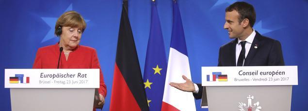 Angela Merkel et Emmanuel Macron, lors du sommet de l'UE, vendredi à Bruxelles.