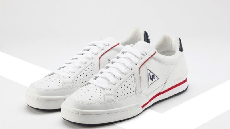 Les sneakers Le Coq Sportif: blanches et perforées, idéales pour l'été. (Le Coq Sportif)