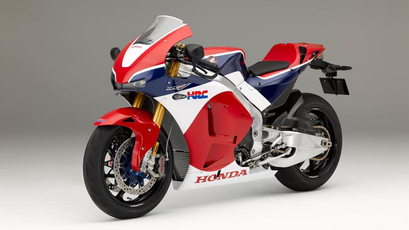 honda rc213v s une moto de grand prix sur la route. Black Bedroom Furniture Sets. Home Design Ideas