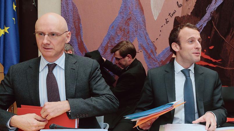 Régis Turrini (à gauche), directeur général de l'APE, et Emmanuel Macron, ministre de l'Économie.