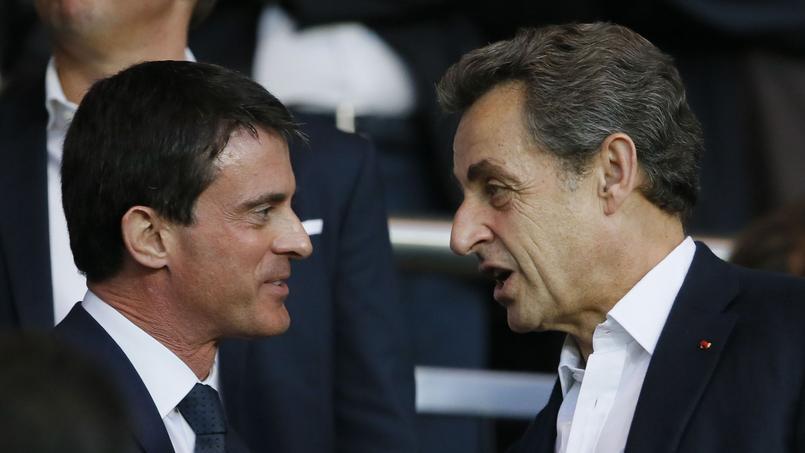 Manuel Valls et Nicolas Sarkozy lors d'un match au Parc des Princes.