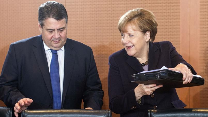 La chancelière allemande Angela Merkel et son ministre de l'Économie, Sigmar Gabriel, le 1er décembre. Si le gouvernement a revu à la baisse sa prévision de croissance pour cette année, c'est davantage en raison du contexte international que pour des raisons intérieures.