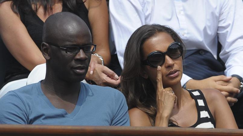 Lilian Thuram et Karine Le Marchant à Roland-Garros en 2010.