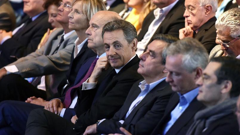 Alain Juppé, Nicolas Sarkozy, François Fillon et Bruno Le Maire rassemblés le 27 septembre 2015 lors d'un meeting des Républicains.