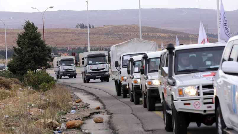 Convoi humanitaire de la Croix Rouge internationale au départ de Damas, le 11 janvier 2016.