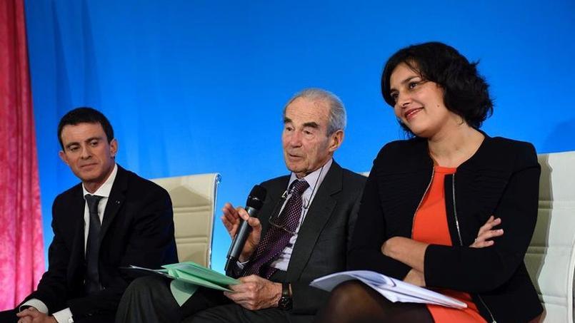 Manuel Valls et Myriam El Khomri, séparés par Robert Badinter, lors de la remise ce lundi du rapport de la commission présidée par l'ex-président du Conseil constitutionnel sur les fondamentaux du futur Code du travail.
