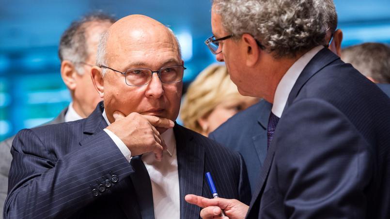 Le Ministre des Finances Michel Sapin, et son homologue luxembourgeois Pierre Gramegna