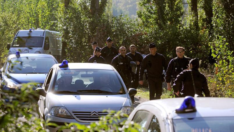 Des policiers dans un camp de roms à Toulouse, en octobre 2013. Crédits photo: ERIC CABANIS/AFP
