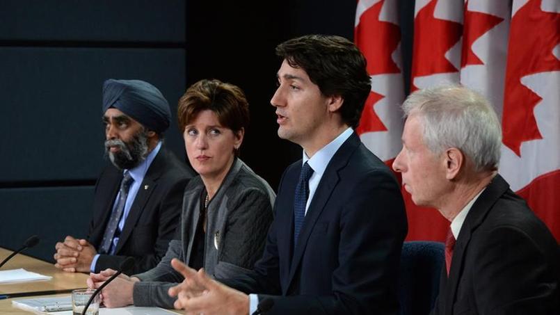Le Premier ministre Justin Trudeau, le ministre de la Défense, Harjit Singh, la ministre du Développement international et de la Francophonie, Marie-Claude Bibeau, et le ministre des Affaires étrangères, Stephane Dion, à Ottawa, le 8 février 2016.