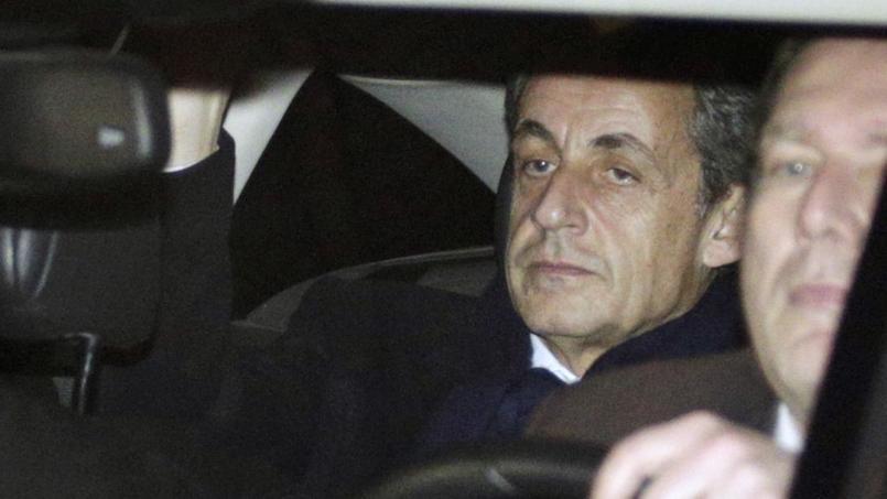 Paris, mardi 16 février. Nicolas Sarkozy, à la sortie du pôle financier du tribunal de grande instance de Paris.