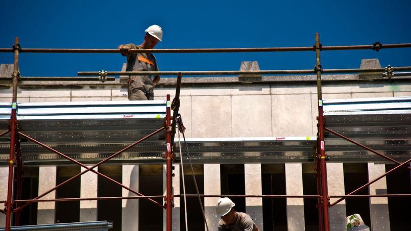 Des travailleurs slovènes sur un chantier.