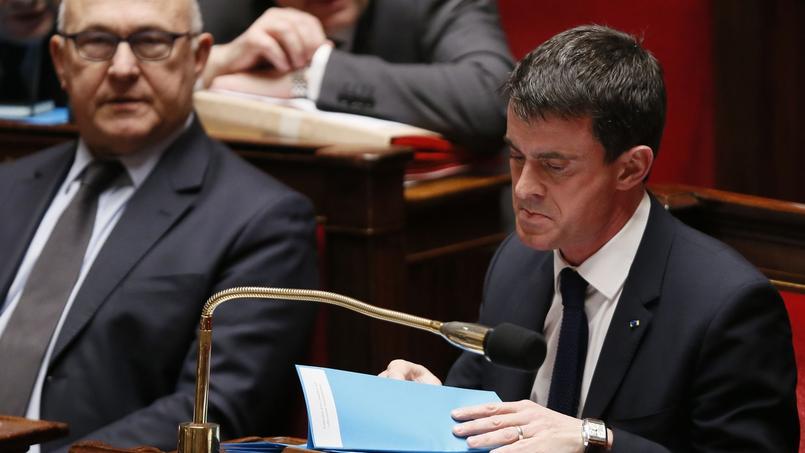 Michel Sapin et Manuel Valls.