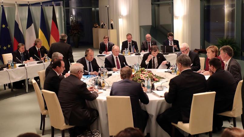 Angela Merkel, François Hollande, Petro Porochenko et Vladimir Poutine, lors d'une réunion sur l'Ukraine, mercredi à Berlin.