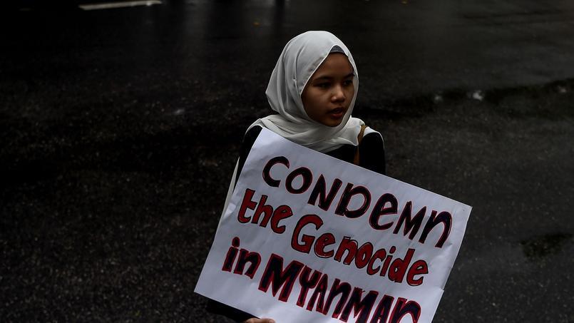 En Malaisie, une petite fille manifeste pour dénoncer «le génocide» opéré en Birmanie, ce vendredi.