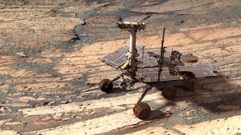 Montage présentant le robot Opportunity sur une image de la surface du cratère Endurance sur Mars.