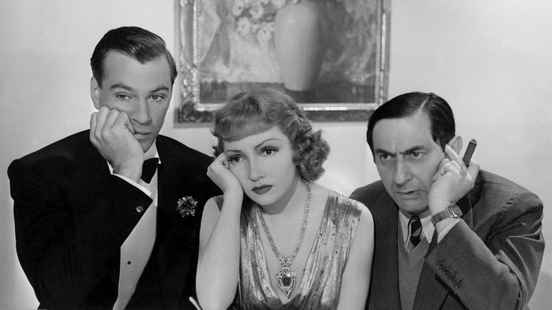 Gary Cooper Claudette Colbert et Ernst Lubitsch sur le plateau du film La huitième femme de Barbe Bleue en 1938.