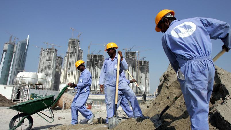 Travailleurs immigrés sur un chantier de Dubai.