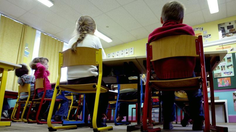 Écoliers dans une salle de cours.