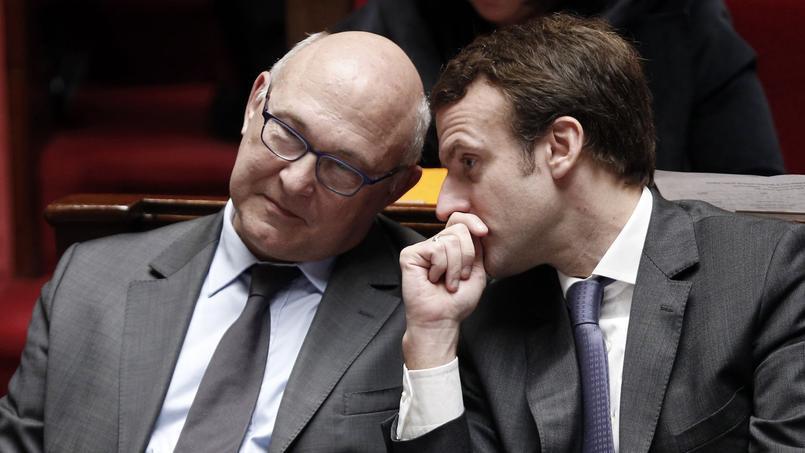 Michel Sapin et Emmanuel Macron à l'Assemblée nationale, le 14 janvier 2015.