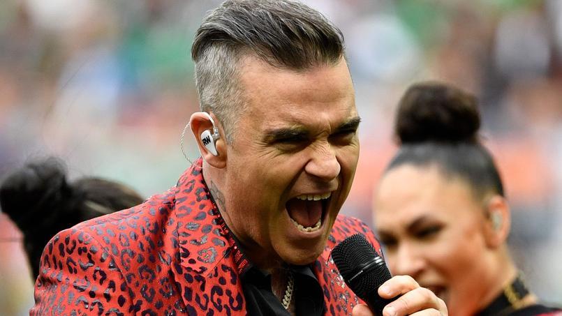 Robbie Williams tente d'expliquer son doigt d'honneur — Coupe du monde