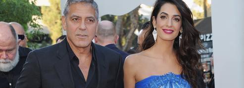 Amal et George Clooney recueillent un réfugié qui a frôlé la mort