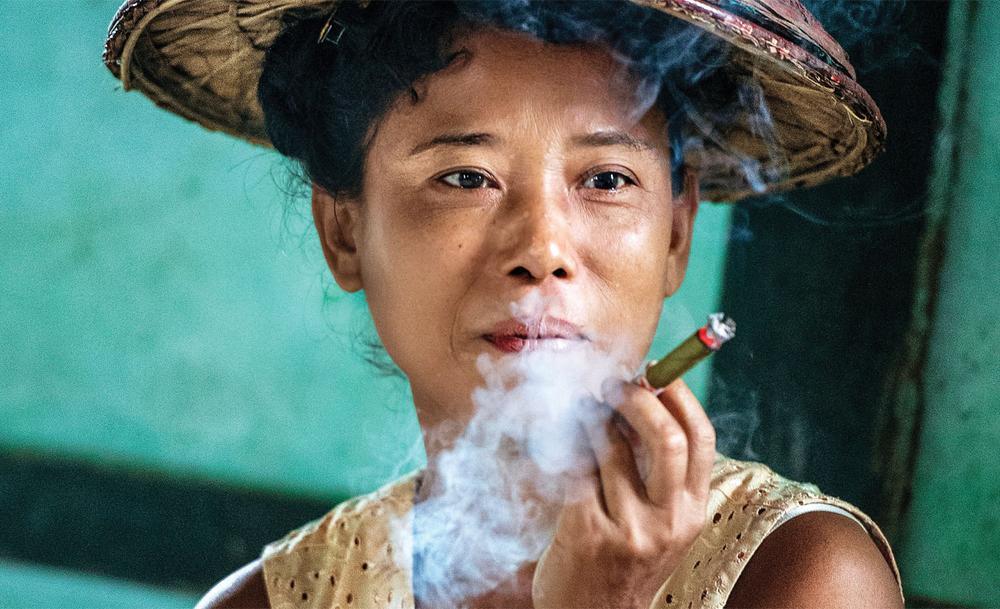 Une villageoise birmane, comme échappée du poème «Mandalay» de Rudyard Kipling.
