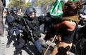 Les images d'un manifestant violemment repoussé lors de la Marche du climat à Paris