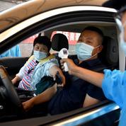 Coronavirus : dix nouveaux quartiers placés en quarantaine à Pékin