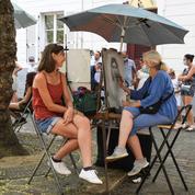 «J'ai l'impression de faire de la figuration» :à Montmartre, les portraitistes font grise mine