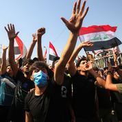 Des milliers d'Irakiens défilent pour le 1er anniversaire de leur «révolution»