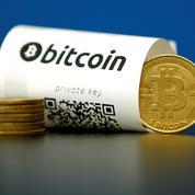 Le bitcoin dépasse son sommet historique et approche des 20.000 dollars